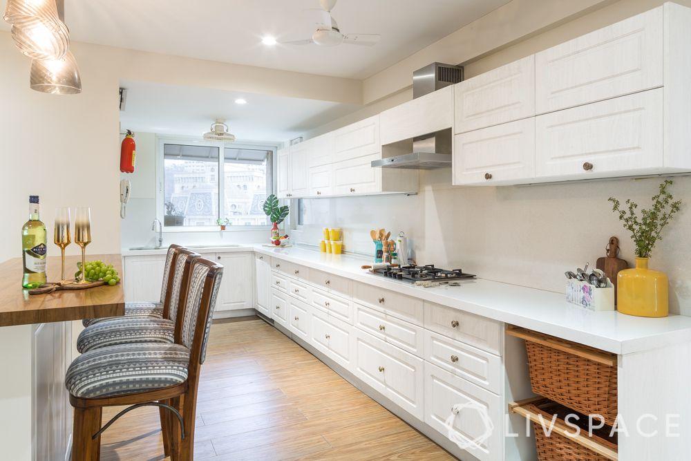 maintain white kitchens-hob-chimney-wooden backsplash