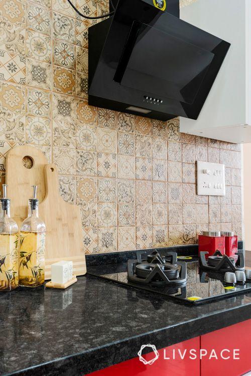 black granite countertop designs-red kitchen cabinets