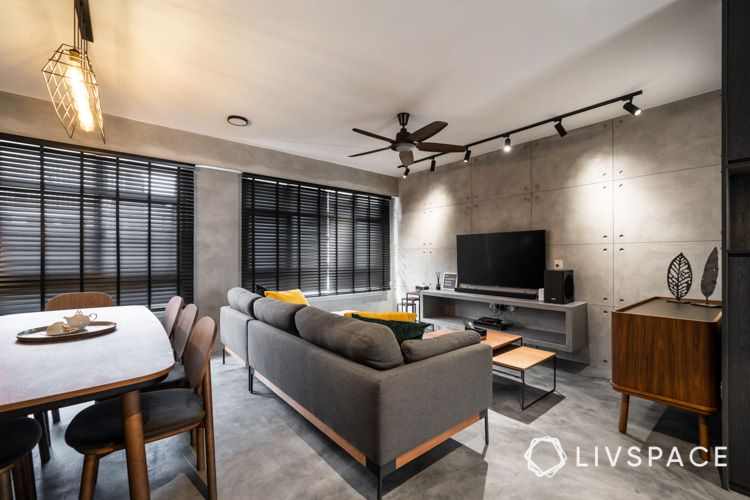 living room-dining chairs-cement-screed-TV-feature-wall-slabs-spotlights-ceiling fan