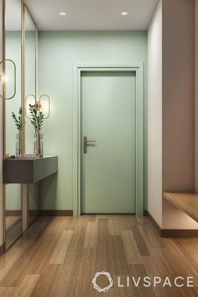 foyer design-pastel green door-wall art-full length mirror-lights-bench