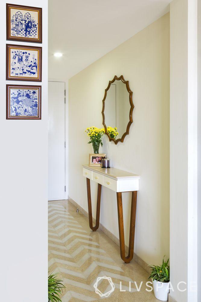 foyer design-mirror-console table-plants-frames