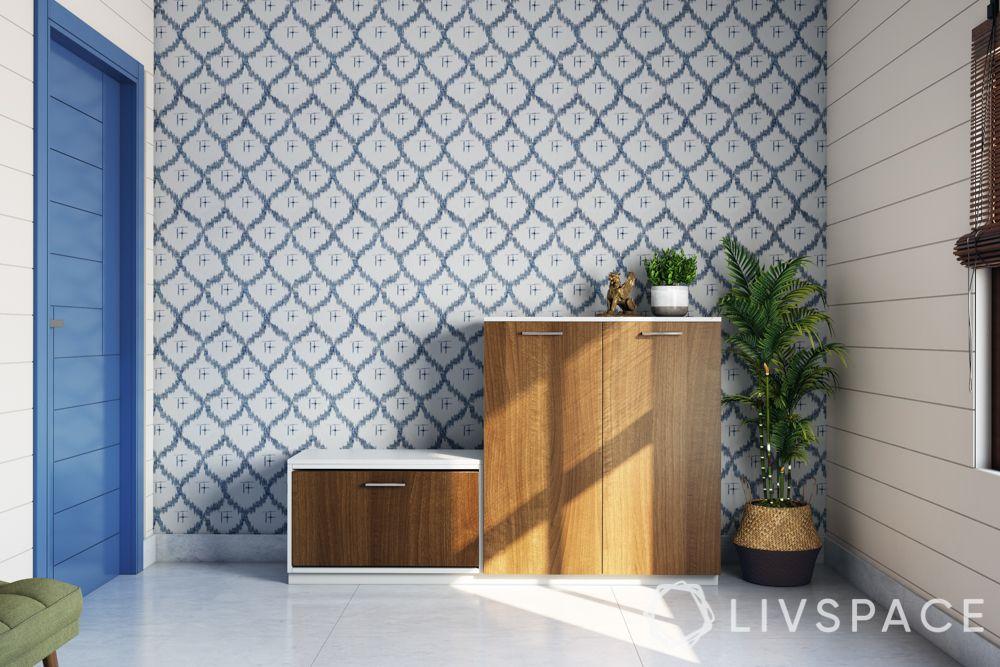 foyer design-wooden shoe rack-green bench-blue pattern wallpaper-blue door