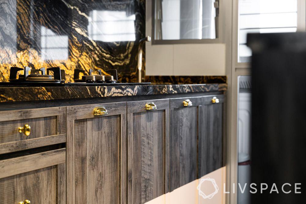 granite countertop-laminate base cabinets-white marble top cabinets-metal handles