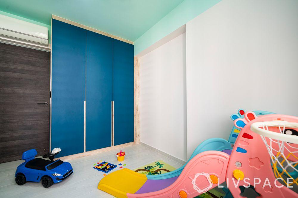 Kids room-blue laminate cupboard-slide-blue ceiling