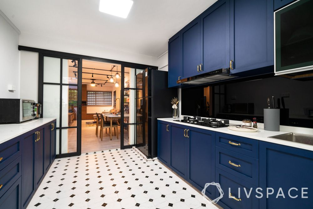 home renovation-blue kitchen cabinets-ikea handles-pattern tiles-glass door