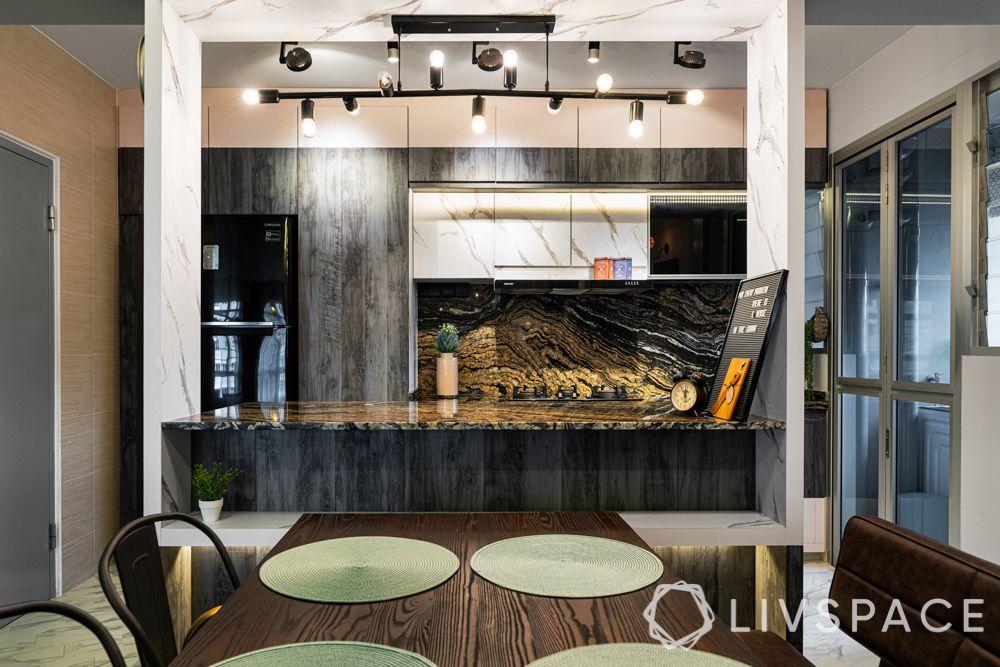 kitchen cabinet design-laminate finish-granite backsplash-track lights