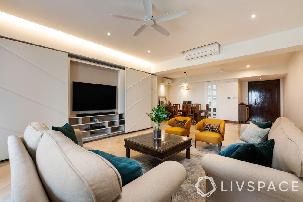 room colour ideas-yellow chairs-white sofas-tv unit