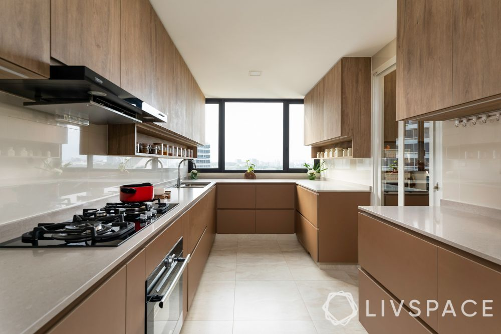 room colour ideas-wooden cabinets-white countertop-window-hob-brown kitchen