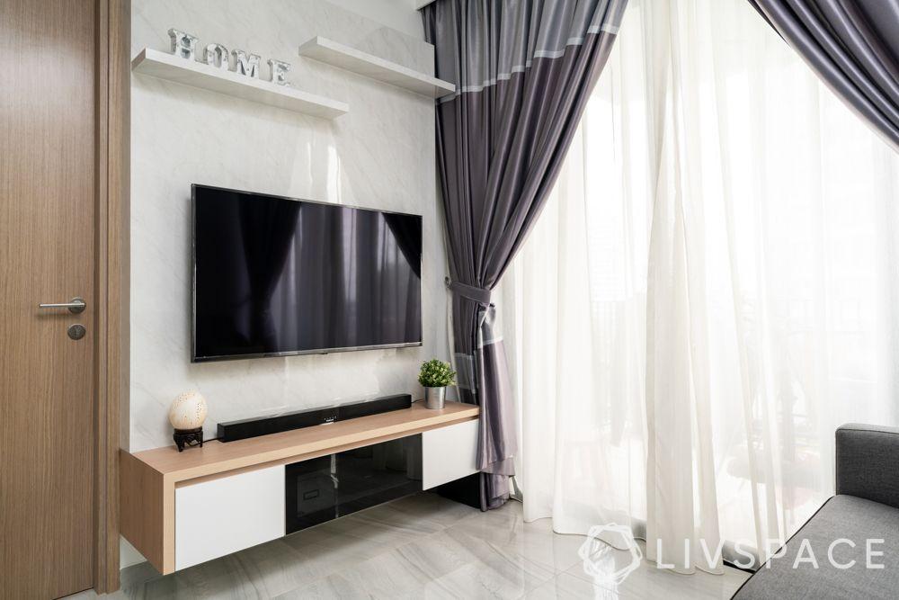 home design-living room-grey curtains-marble finish laminate-grey sofa-track lights