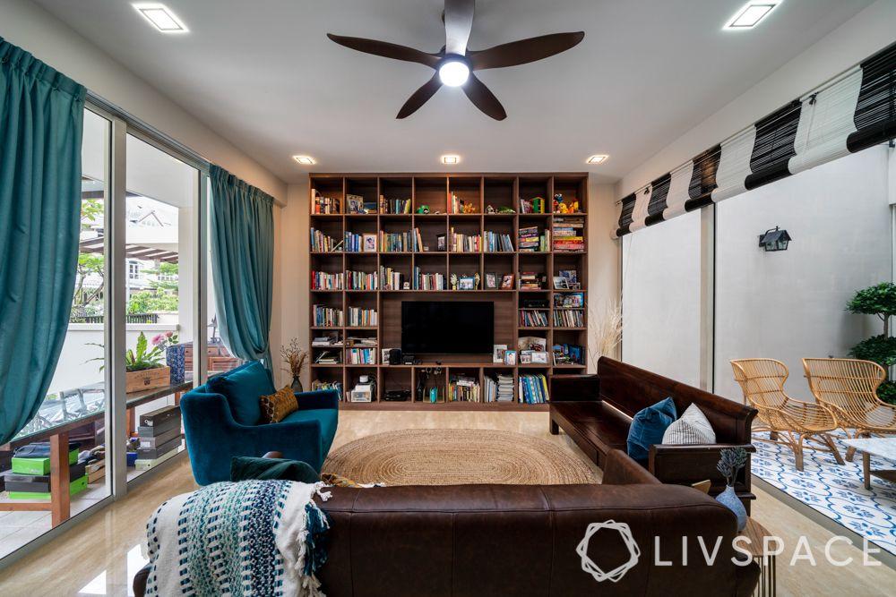 tv-wall-design-wooden-book-shelves-brown-blue-sofa