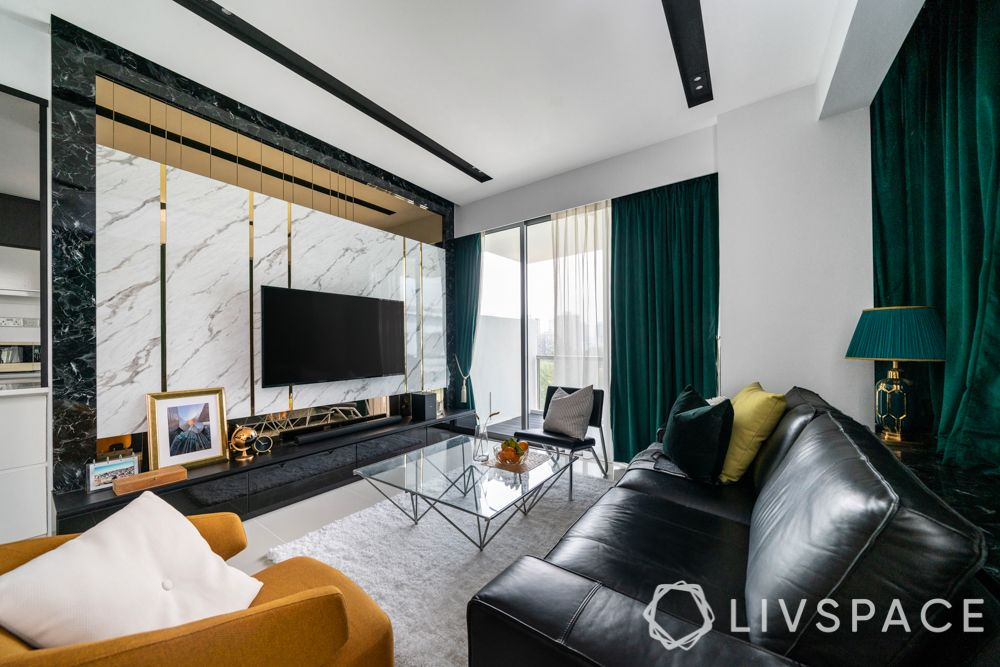 false ceiling-black and white ceiling-marble designs-green curtains-tv unit