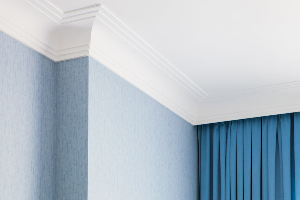 white cornices-blue wall