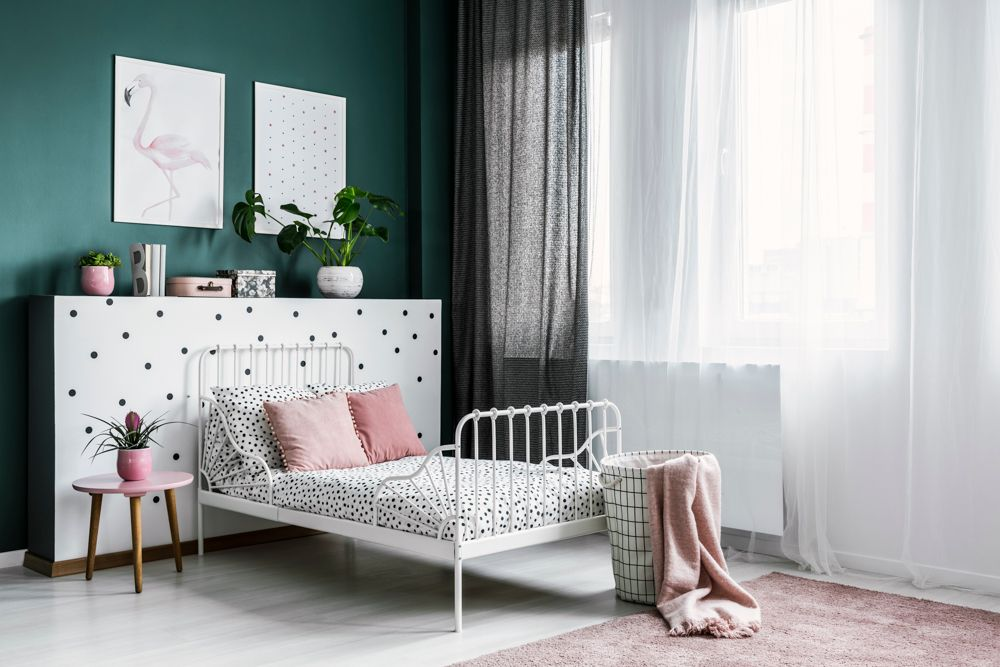 white bed-green wall-pink decor