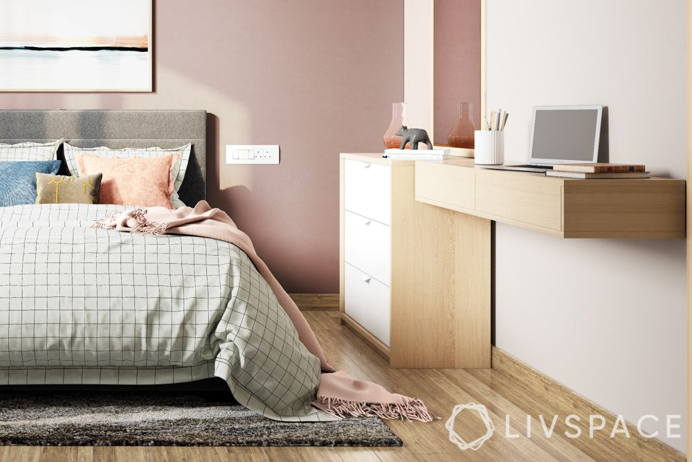 wall mounted unit-pink walls-grey bed-drawer