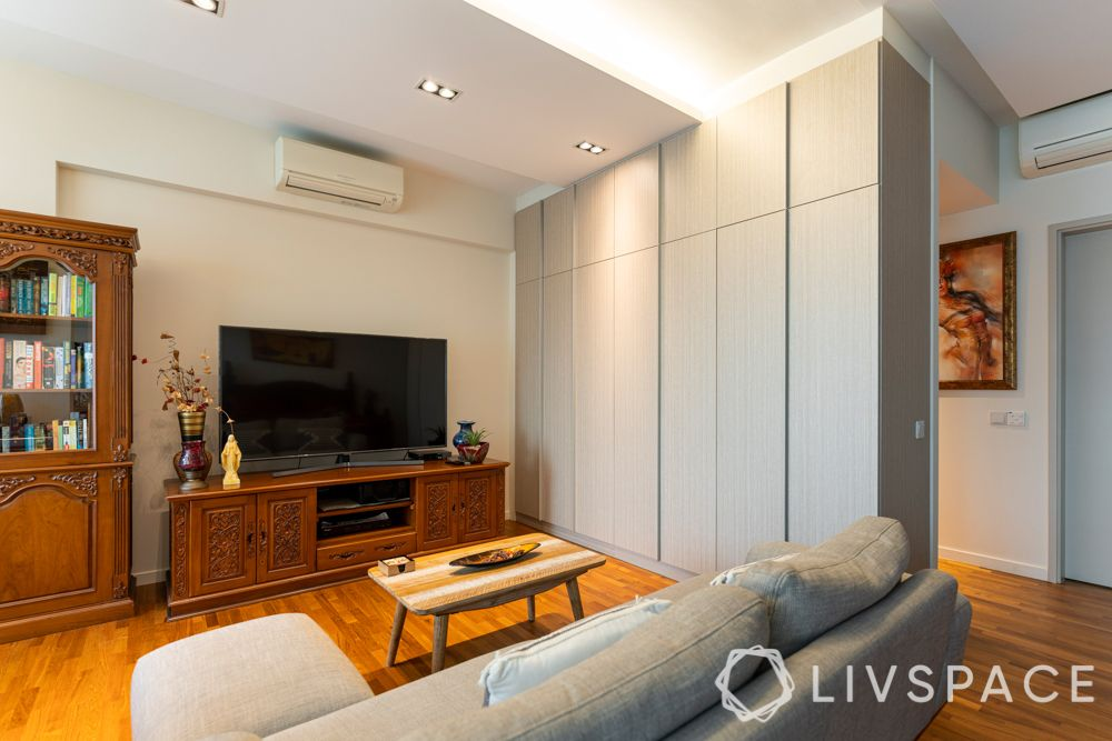 condo-interior-design-ideas-singapore-bedroom-lounge-area-wooden-flooring