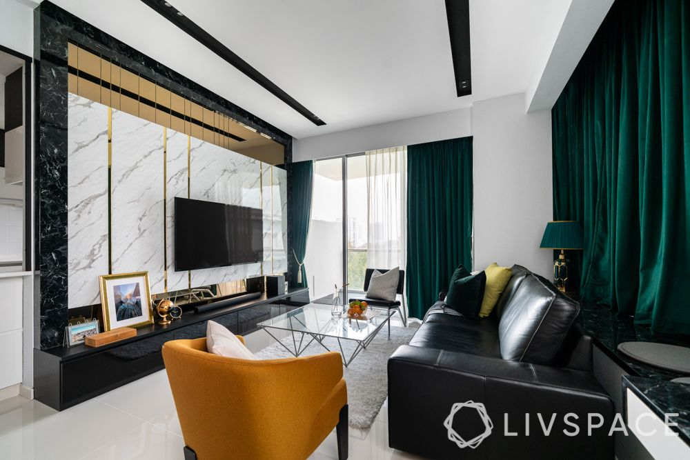 condo-interior-design-ideas-singapore-living-room-black-sofa-marble-laminate
