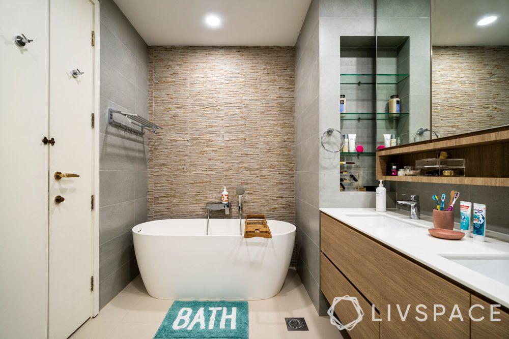 3-room-condo-master-bath-bathtub-stone-wall