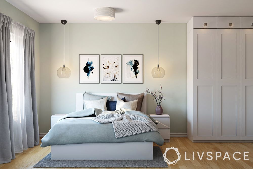 design-singapore-master-bedroom-white-bed-wall-frames-green-walls
