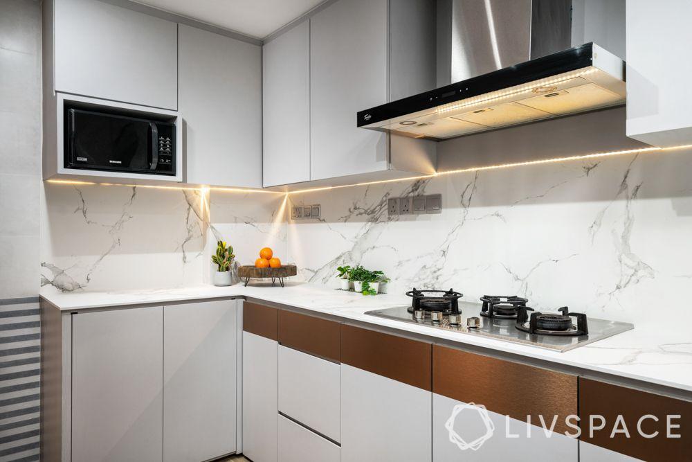 house-interior-design-kitchen-grey-cabinets-metallic-highlights