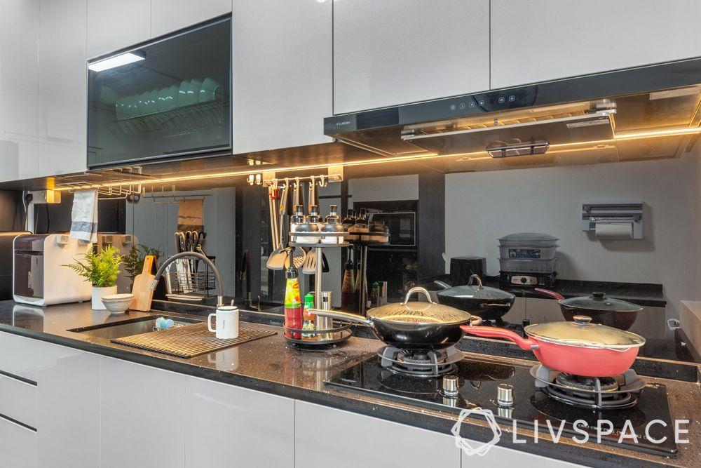 5-room-hdb-renovation-kitchen-hob-unit-black-backsplash