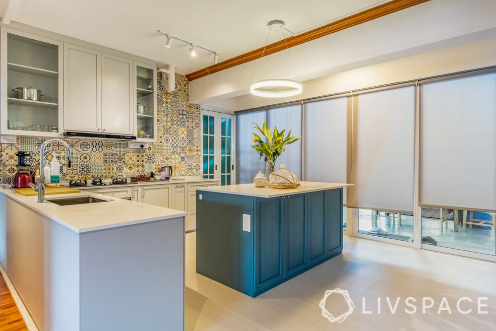 kitchen-with-an-island-scandinavian-white-cabinetry-blue-island