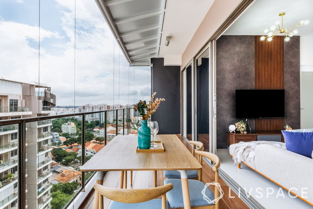4-bedroom-condo-sit-out-balcony-wooden-table