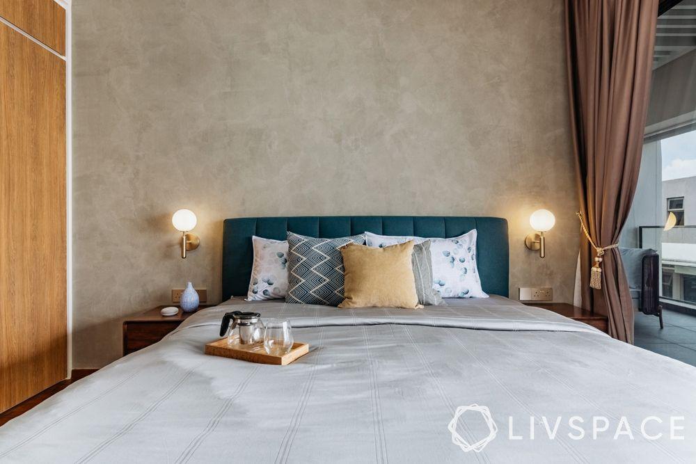 4-bedroom-condo-master-bedroom-bed-blue-headboard