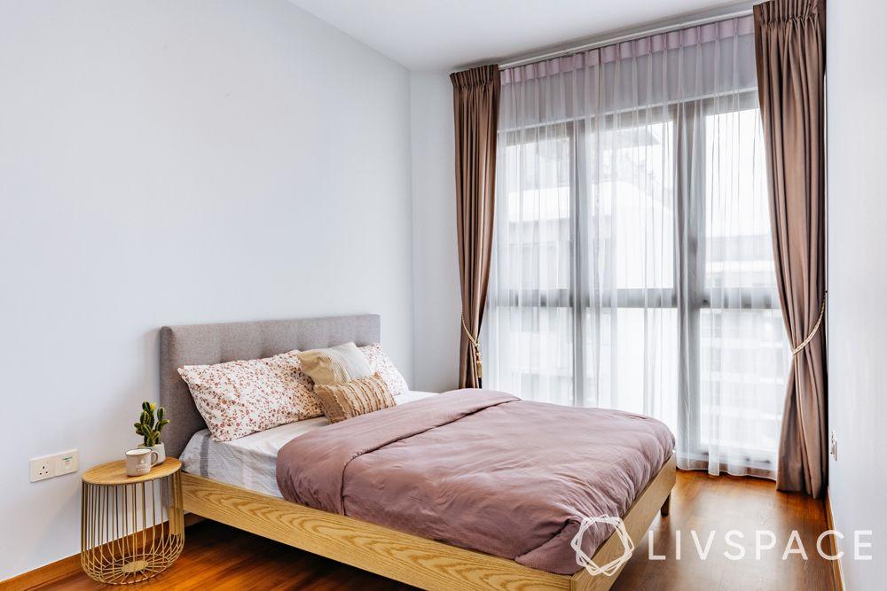 4-bedroom-condo-guest-bedroom-wooden-bed-flooring