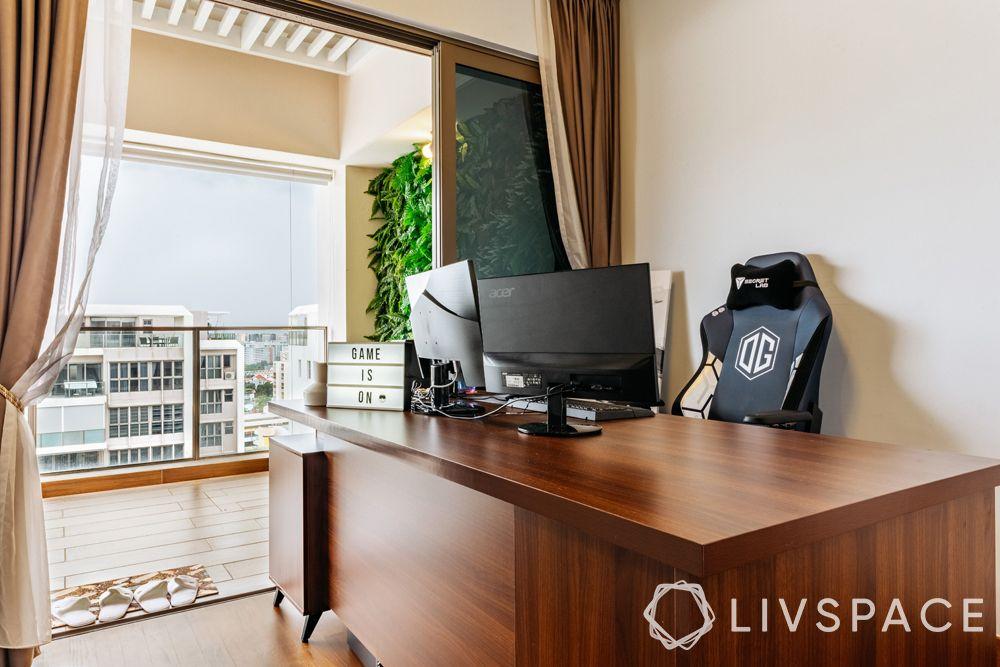 4-bedroom-condo-game-room-wooden-table