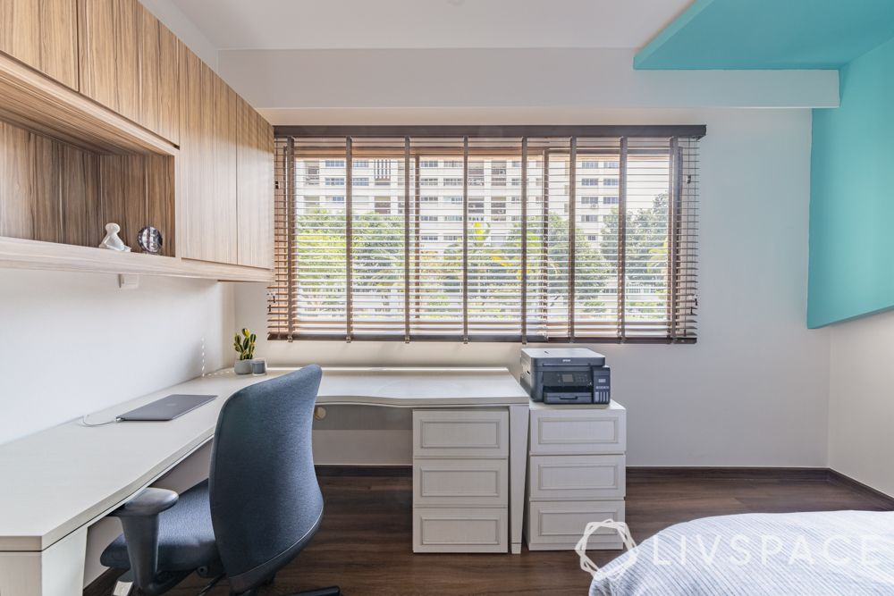 modern-interior-design-son-bedroom-study-table-wooden-wall-cabinets