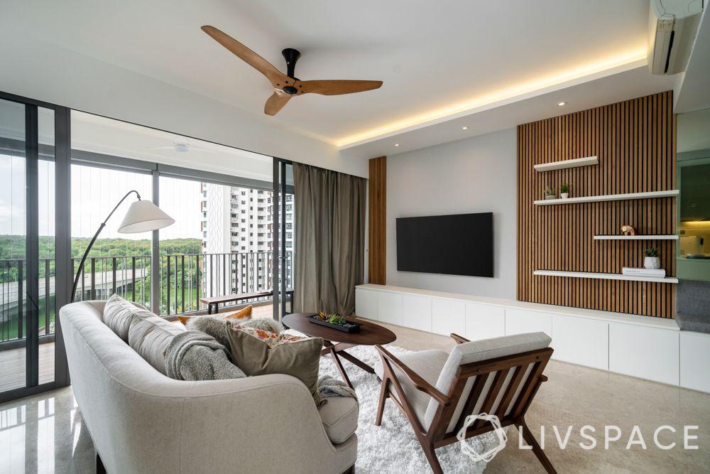 scandinavian-living-room-white-sofas-fluted-wooden-panels-tv-unit