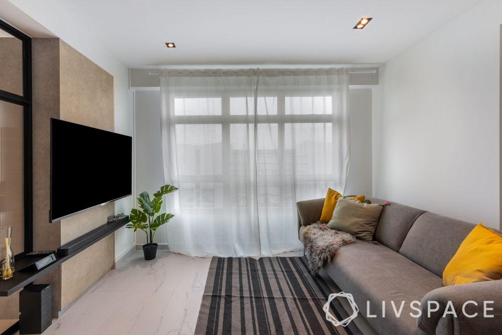 scandinavian-living-room-sheer-drapes-prited-rug-grey-sofa