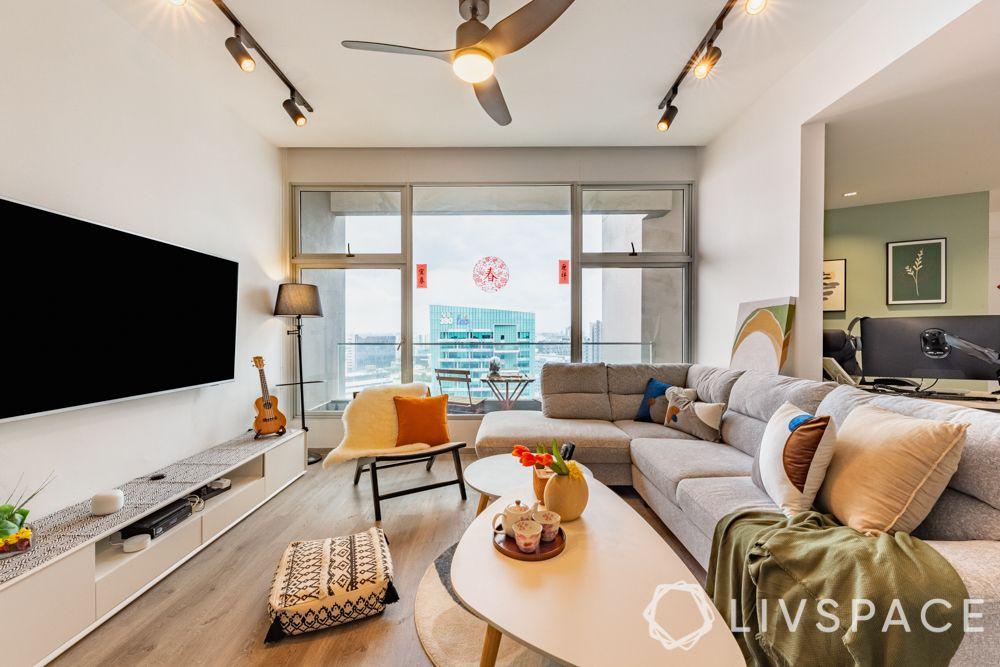 3-room-renovation-living-room-grey-sofa-accent-chair-boho-cushion