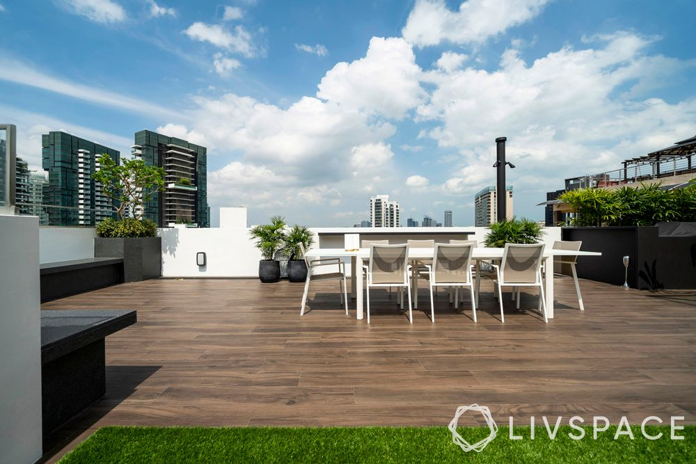 penthouse-condo-rooftop-dining-area-wooden-deck
