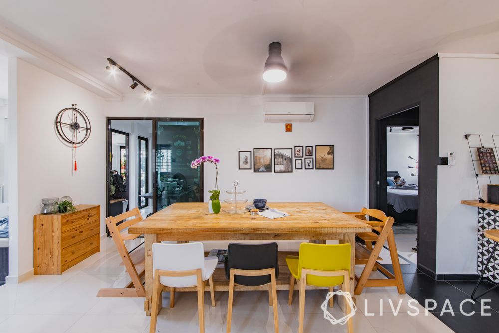 3gen-flats-dining-room-colourful-chairs-wall-frames-crockery-unit