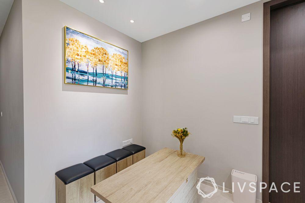 1-bedroom-condo-dining-room-wall-art-painting-bench
