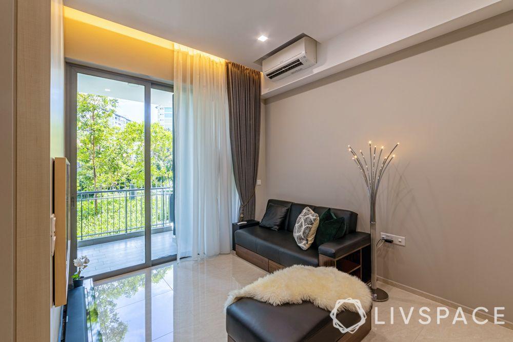 1-bedroom-condo-living-room-black-sofa-layered-curtains