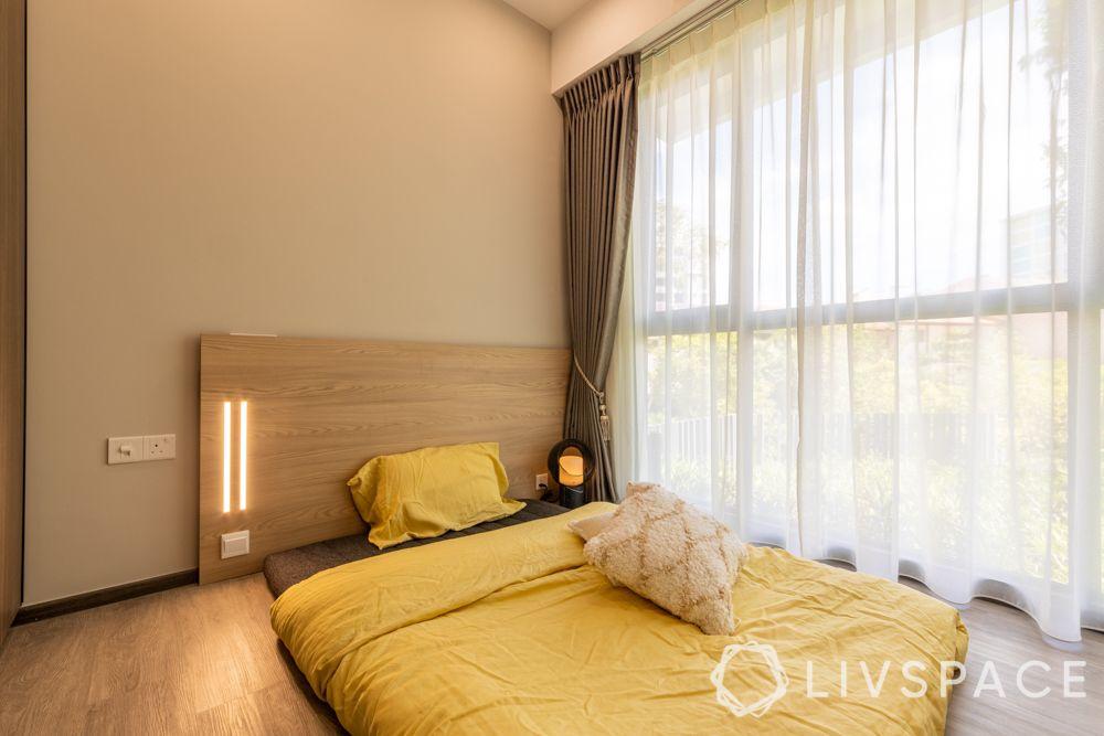1-bedroom-condo-bedroom-mattress-headboard-light