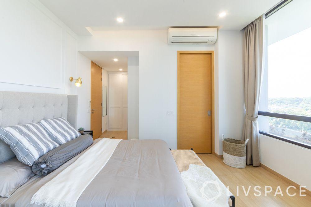 scandinavian-bedroom-view-shaker-style-light-wood-flooring-upholsetred-wing-bed