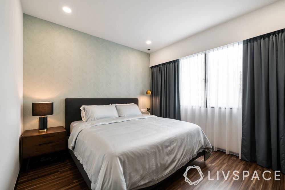 scandinavian-bedroom-plush-soft-furnishings-dark-wood-chevron-wallpaper