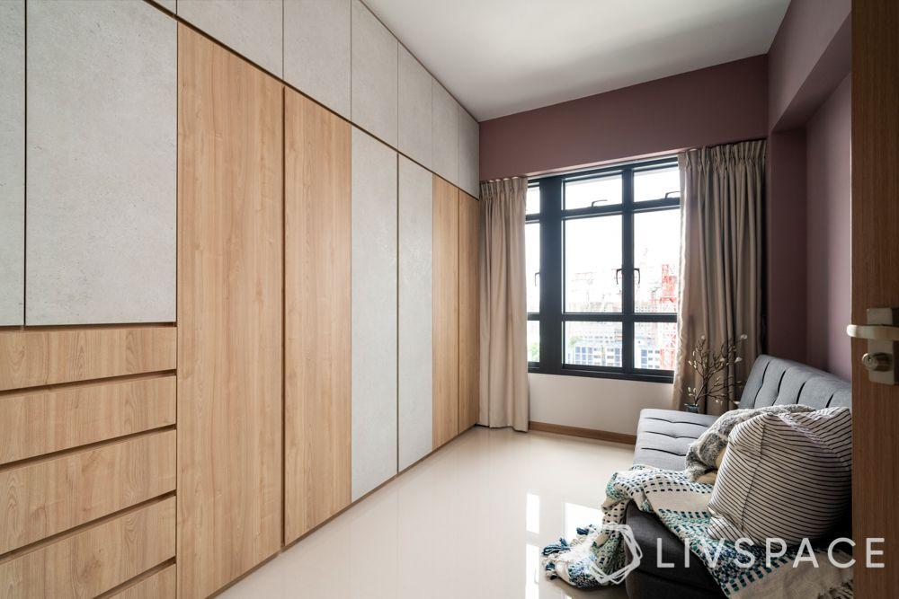 space-saving-ideas-common-room-wall-to-wall-wardrobe