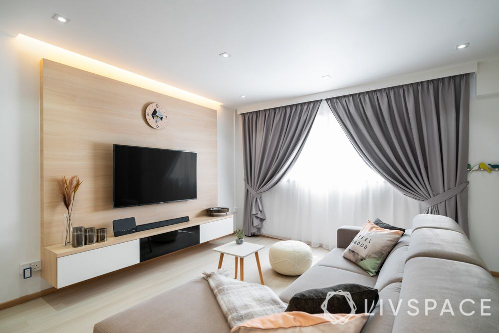 hdb-living-room-design-light-colours-grey-couch-wooden flooring-grey-drapes