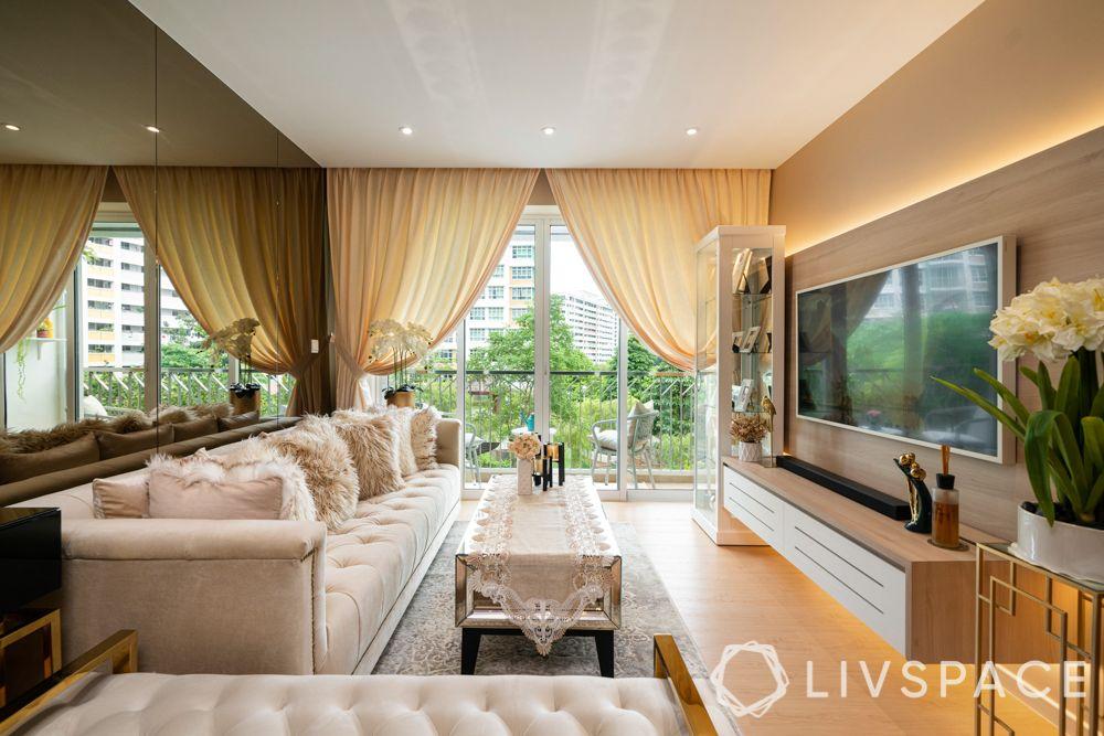 hdb-living-room-design-wall-mirrors-plush-sofa-wooden-flooring-coffee-table-display-cabinet