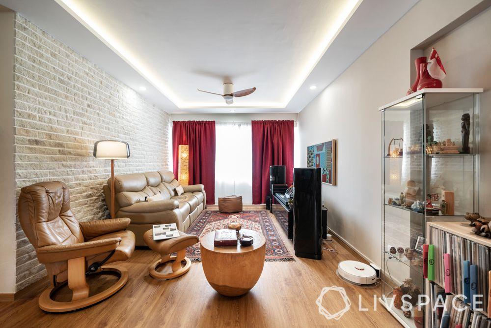 decor-maroon-curtains-carpet-beige-sofa-stone-wall-wooden-flooring