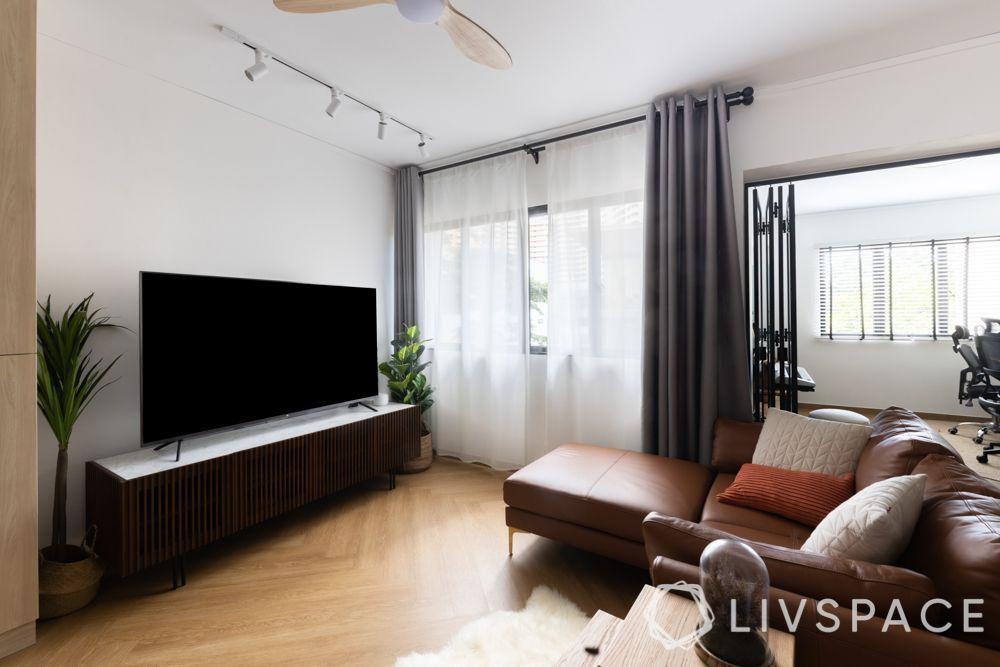 hdb-living-room-design-warm-brown-leather-sofa-wooden-flooring-dark-brown-TV-unit