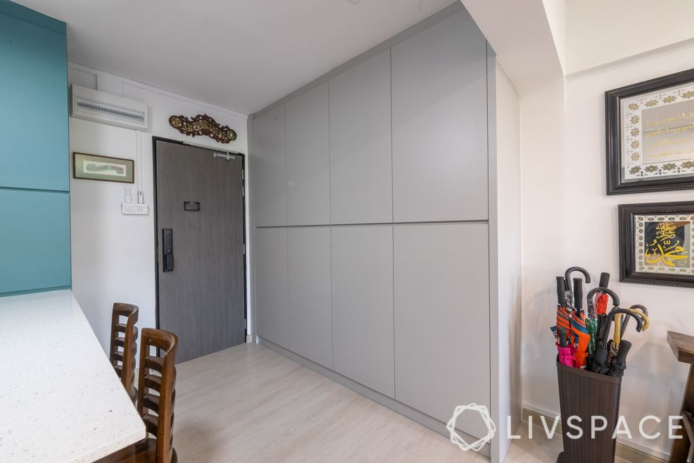 executive-apartment-entryway-grey-cabinets-umbrella-holder