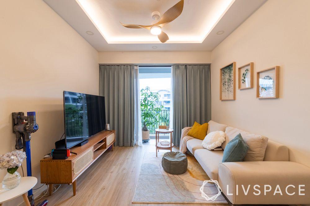 small-condo-design-ideas-living-room-white-wall-sofa-grey-rug-false-ceiling