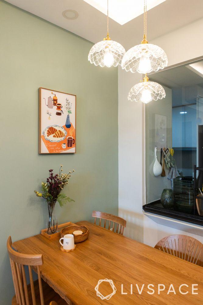small-condo-design-ideasdining-room-green-wall-poster-pendant-light-wooden-furniture