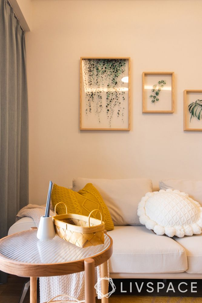small-condo-design-ideas-living-room-glass-paintings-coffee-table-throw-pillows