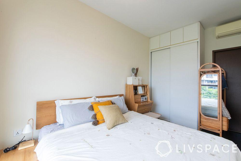 small-condo-design-ideas-bedroom-white-walls-sliding-door-wardrobe-dresser-dresser-unit